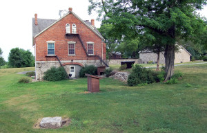 Nauvoo House showing the original cornerstone (foreground, left). Photo by Kenneth Mays.