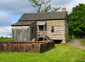 Rear view of the Smith Palmyra log home with the sawn-slab addition. Photo by Kenneth Mays