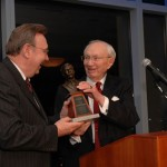Kim R. Wilson, Chair of the Mormon Historic Sites Foundation, presents President Gordon B. Hinckley with the first anuual Junius F. Wells Award.
