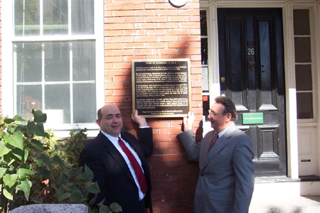 Jonathan C. Felt, great-great-grandson of Nathaniel H. Felt, and Kim R. Wilson, the chairman of the MHSF, hold up the plaque at the Nathaniel Felt Home.  Photo courtesy Fred E. Woods