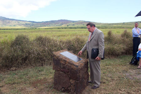 Kim R. Wilson, chairman of the MHSF reading the Palawai Pioneer Monument.  Photo courtesy Fred Woods