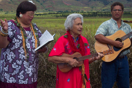 "Genoa Keawe leads the Saints gathered for the commemoration in the hymn ""Come, Come Ye Saints"" on a ukulele.  Photo courtesy Fred Woods"