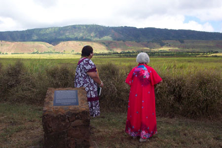 Genoa Keawe, (on the right) while facing the Palawai Basin, sings to her Latter-day Saint Hawaiian ancestors who have gone before.  Photo courtesy Fred Woods