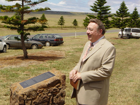 Kim R. Wilson, chairman of the MHSF in front of the Palawai Pioneers Monument at the commemoration ceremony.  Photo courtesy Fred Woods