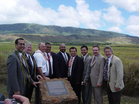 In the background is the Palawai Basin which was the first gathering place for the Hawaiian Saints which commenced in 1854. From left to right: Arnold Wunder, Kahului, Hawaii Stake President; Ronald K. Hawkins, Honolulu, Hawaii Mission President; Riley Moffat, Head Reference Librarian for BYU-Hawaii; Fifita Niu, monument builder; Paula Ngalu, assisted with buildling of monument; Herb Yuen, 2nd Councelor in Kahului Stake Presidency, Kim R. Wilson, chairman of the MHSF and Fred E. Woods, BYU Professor of Church History & Doctrine and executive director of the MHSF.  Photo courtesy Jace McQuivey, General Counsel, Hawaii Reserves, Inc.
