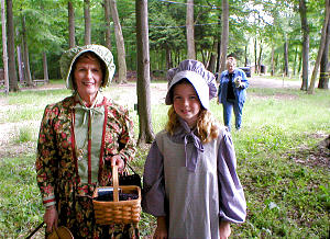 Barbara Whidden, as Eliza R. Snow, and Amanda Wright, in History Center's Living Village where Kirtland visitors can experience life in early days of Church. Photo by Cheryl McClellan, LCHS staff