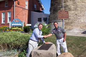 Fred E. Woods, executive director of the Foundation (left) and Fairport Harbor Mayor Frank Sarosy (right) shake hands over the historical marker. Photo courtesy Fred E. Woods