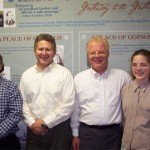 From left to right: John Ollila, Trustee for the Fairport Marine Museum, Fred E. Woods, executive director of the MHSF, Steve Olsen, Associate Managing Director for the Historical Department of The Church of Jesus Christ of Latter-day Saints, and his daughter Chelsea Olsen  Photo courtesy Fred E. Woods