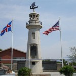 The lighthouse portion of the memorial was erected in 1938. The Icelandic Memorial Wall of Honor lies in the background along with the Icelandic and American Flags.  Photo courtesy Derek J. Tangren
