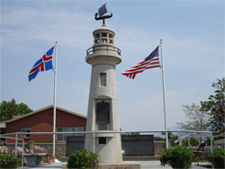 The Icelandic Memorial (shown behind) was dedicated on June 25, 2005. A similar monument was constructed in Iceland on the Westmann Island in 2000. Photo Courtesy Derek J. Tangren