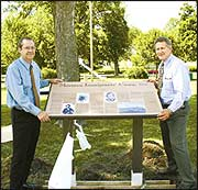 Steve Dunn / Gate City Kirk Brandenberger (left), executive director of the Keokuk Area Convention and Tourism Bureau, and BYU professor Fred Woods stand by the new historic marker in Triangle Park in Keokuk that will be dedicated Saturday afternoon. Woods also is executive director of the Mormon Historic Sites Foundation that paid for new curbs in part of Triangle Park where the marker is located.