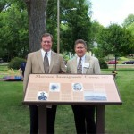 Robert S. Clark (left), MHSF board trustee, and Fred E. Woods (right), MHSF executive director, standing in front of the of the marker at Triangle Park.  Photo courtesy Fred E. Woods