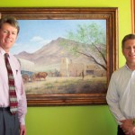 Jonathan W. Bullen, trustee board member of the Foundation, and Fred E. Woods, executive director of the Foundation, stand in front of 'A Gamble in the Desert,' by Ken Corbett which MHSF commissioned and donated.  Photo courtesy Fred E. Woods