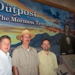 (From left to right): Fred E. Woods, executive director of MHSF, Chris Macek, Old Mormon Fort park ranger, and Garry Hayes, a member of the Las Vegas sesquicentennial commemoration committee, stand in front of the newly remodeled exhibit which tells the story of the Mormon Mission in Las Vegas. It is part of a series of exhibits which tell the history of Las Vegas in the Las Vegas Old Mormon Fort Visitor's Center. MHSF helped by supply Consortium West with information for the exhibit.  Photo courtesy Fred E. Woods