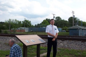 Douglas Atterberg, a local historian, recounts part of the history of Fort Des Moines where the Foundation created this historical marker. Photo courtesy Fred E. Woods