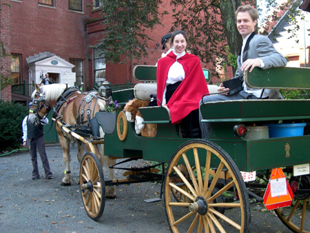 Nicole Benvie, portraying Vilate Young, and Fred Brown, portraying Brigham Young, arrive in horse-drawn carriage during the plaque dedication ceremony. Right is view of the Nathaniel Felt home as part of the Peabody-Essex Museum campus. Photo courtesy Jonathan Felt