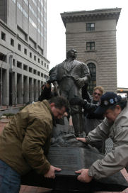 Joseph Smith statue is put in place by Utahns [Matt Kennedy and Steve Glenn] who came to New York for the installation. Photo by Carl Glassman