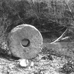 The Hawn's Mill Millstone photo in 1907 by George Edward Anderson.