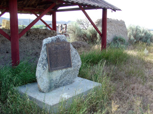 Historical plaque adjacent to a remnant of adobe wall of Fort Lemhi. Photo by Kenneth Mays.