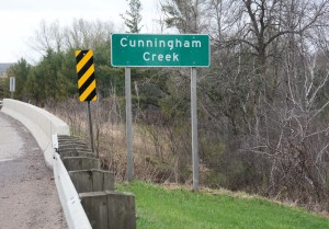 Sign identifying Cunningham Creek where it flows near Neillsville.