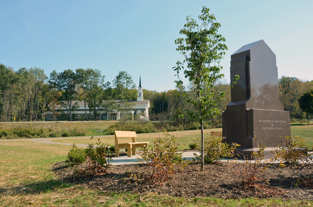Aaronic Priesthood monument with new visitor center in the background.
