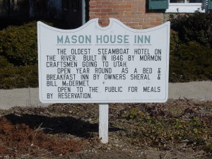 Sign noting that the Mason House Inn at Bentonsport was built by Mormons heading west. Photo by Kenneth Mays.