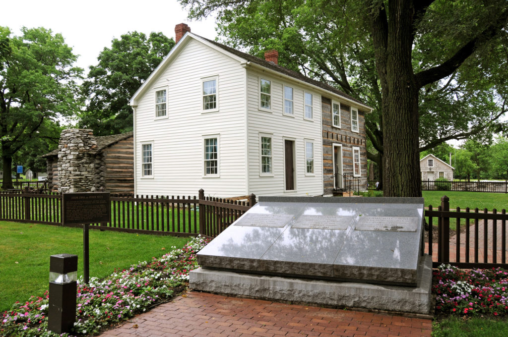 Joseph Smith Homestead with the graves of Joseph, Emma and Hyrum in the foreground. Photo (2008) by Kenneth Mays.