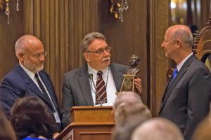 Kim Wilson & Jeffrey Walker presenting the Junius Wells Award to Richard E. Turley, Jr.